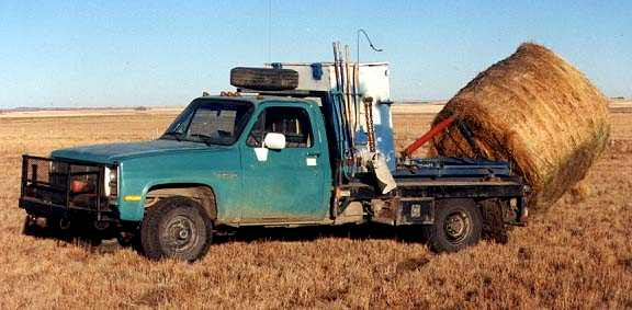 Truck with grain box and hay bale (27116 bytes)
